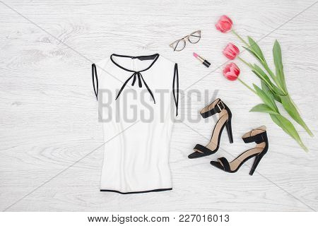 Fashion Concept. White Blouse, Glasses, Lipstick And Pink Tulips. Top View