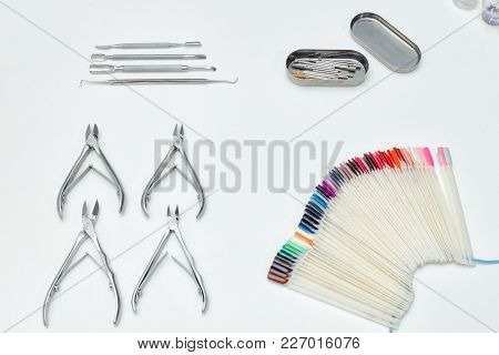 Set For Manicure. Tools, Tongs, Palette, Care Products. White Background.