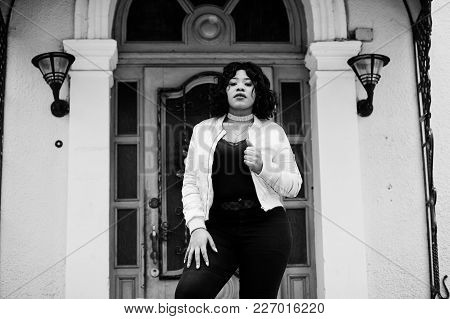 Stylish African American Plus Size Model At Streets Of City Against Enter Of House.