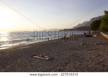 Tucepi, Croatia - August 15 2017: Tucepi Beach At Sunset Time In Croatia, With Few People