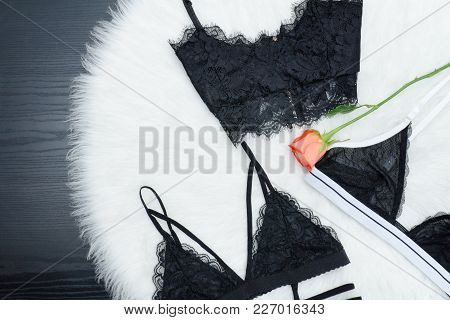 Fashion Concept. Three Lace Bustier On A White Fur. Top View