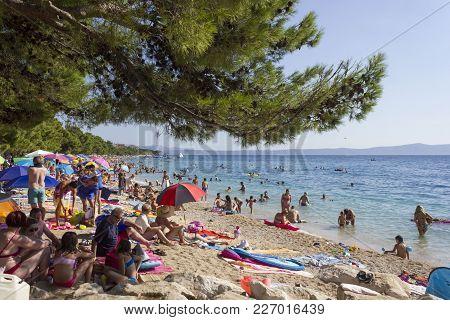 Baska Voda - Croatia - August 15 2017: Crowd Of People Od Vaska Boda Beach In Summer Season