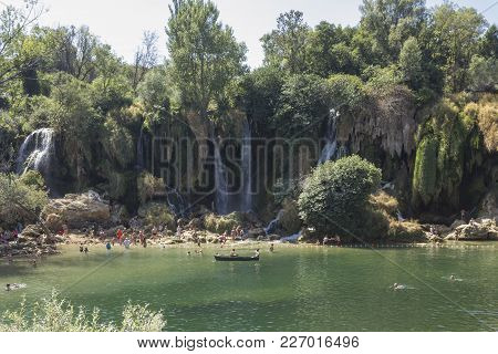 Studenci, Bosnia And Herzegovia - August 16 2017: Natural Parkland Ok Kravice Waterfalls In Bosnia H