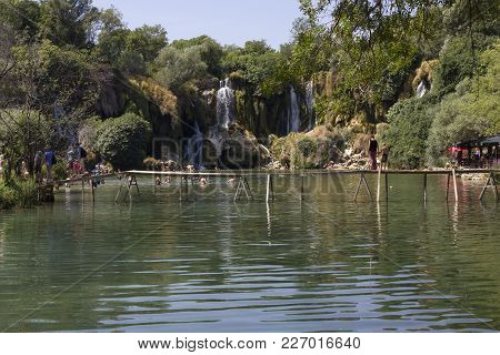 Studenci, Bosnia And Herzegovina - August 16 2017: Kravice Waterfalls  In Bosnia Herzegovina, With A