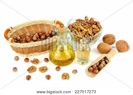 Oil Of Walnut And Hazelnut, Nut Fruit Isolated On White Background.