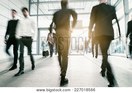 Blurred People In Business Center Entrance