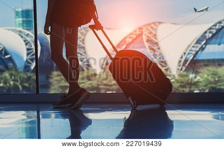 Silhouette Woman Travel With Luggage Walking Side Window At Airport Terminal International Or Girl T
