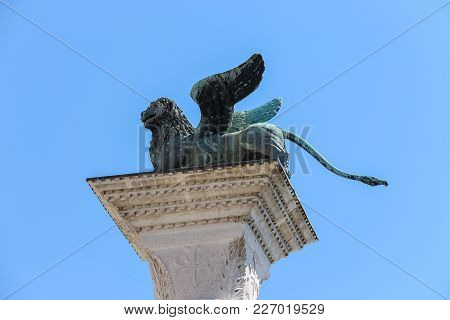 Column Of San Marco On Famous St. Mark's Square In Venice, Italy