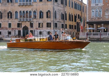 Venice, Italy - August 13, 2016: People In Taxi Boat On Canal Of Venice