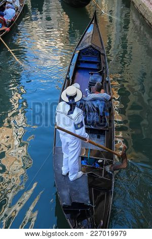 Venice, Italy - August 13, 2016: Tourists In Gondolas On Canal Of Venice