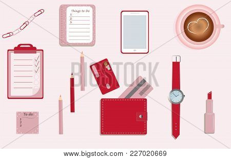 Stationary. A Planner. To Do Lists. A Cup Of Coffee. Pencils. A Wallet. Wrist Watch. Credit Cards. M