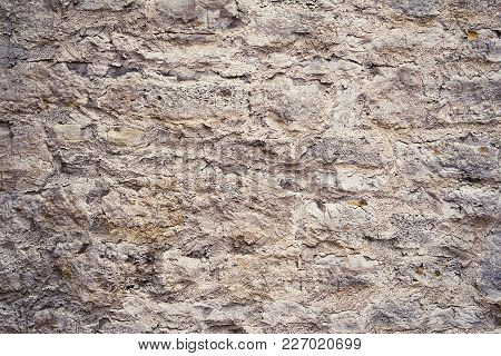 Beige And Brown Natural Stone Wall As A Texture Or For Background