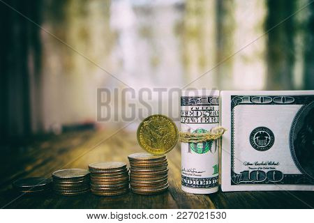 One Hundred Dollars Banknotes Of The Stack Of Coins From Quarters And One Dollar. Copy Paste/