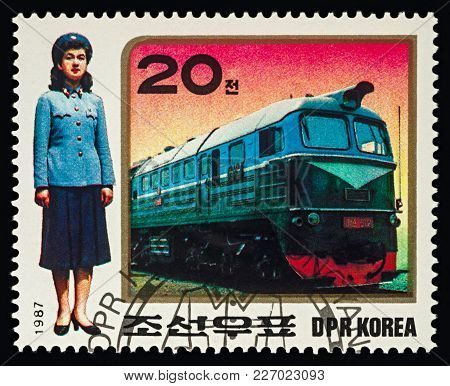 Moscow, Russia - February 17, 2018: A Stamp Printed In Dprk (north Korea), Shows Diesel Train And Wo