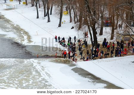Gomel, Belarus - January 19, 2018: Unknown People Visit Traditional Epiphany Bathing In Sozh River,