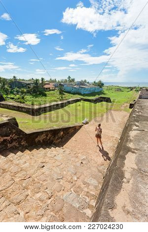 Sri Lanka, Asia, Galle - A Woman Visiting The Medieval Town Wall Of Galle