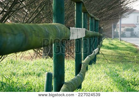 Fence In The Green Field Near The Road, Good For Background.