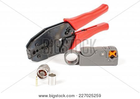 Professional Tool For Coaxial Cable Preparation, Crimping And Termination Isolated On The Bright Bac