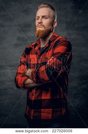 A Stylish Bearded Redhead Male Dressed In A Red Fleece Shirt.