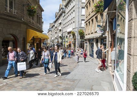 Saint Malo, Brittany, France - July 2, 2017: Tourists And Shoppers On A Busy Street Rue Porcon De La