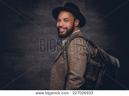 Bearded Black Man  Wearing A Wool Suit And A Felt Hat Holds Backpack.