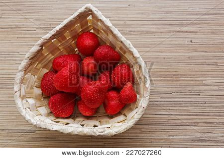 Defrozen Strawberries In A Basket. Closeup Of A Basket Full Of Defrozen Juicy Strawberries
