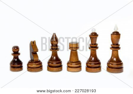 The Shot Of The Black Chess Set Of Wood On The White Background. The Chess Piece Is Isolated On Whit