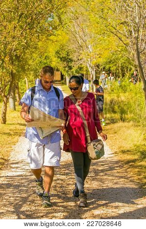 Johannesburg, South Africa, 05/10/2014, Young Couple Walking On A Path With A Map At The Winter Scul