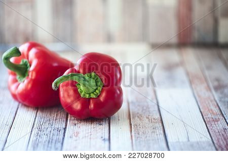 Juicy Red Peppers On A Natural Rustic Background
