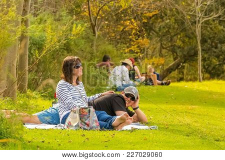 Johannesburg, South Africa, 05/10/2014,  A Young Couple Lying On A Picnic Blanket At The Winter Scul