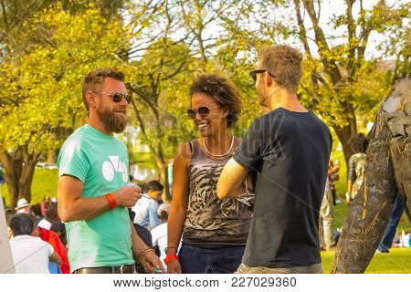 Johannesburg, South Africa, 05/10/2014,  Friends Laughing At The Winter Sculpture Fair At Nirox Scul
