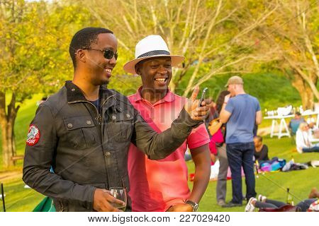 Johannesburg, South Africa, 05/10/2014,  Two African Men Taking A Selfie At The Winter Sculpture Fai