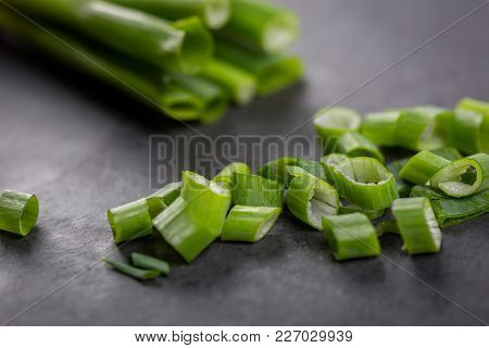 Top Down View On Bundle Of Whole And Chopped Raw Green Onions, Washed And Ready For Preparation On C