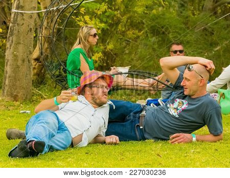 Johannesburg, South Africa, 05/09/2015, Gay Couple Lying On The Grass At The Winter Sculpture Fair A