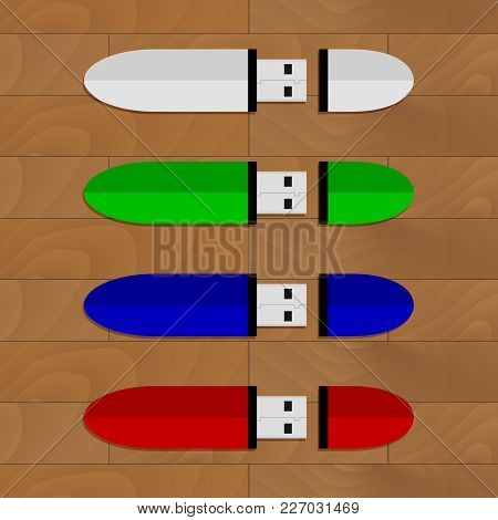 Flash Drive Set Collection On Table. Vector Memory Storage Usb-stick, Usb Flashdrive On Wooden Desk