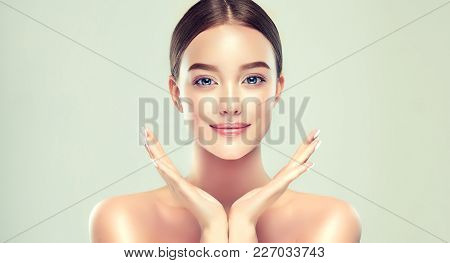 Beautiful young woman with clean fresh skin. Girl beauty face care. Facial treatment. poster