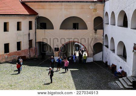 Mukachevo, Ukraine - August 23 , 2017 , Tourists Are Walking In The Yard Of The Palanok Castle Or Mu