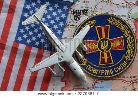 ILLUSTRATIVE EDITORIAL. Chevron of Ukrainian army. Back - Eastern Regions map. Location MH17 crash and toy liner.Kiev,Ukraine.February 9, 2018