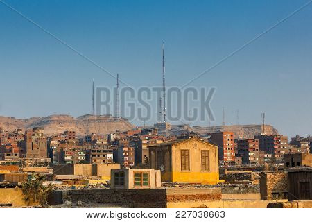 Evening View On Slums In Cairo With Radio Towers On Hill