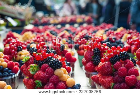 Yellow Red Raspberries And Blackberries At A Farmer S Market