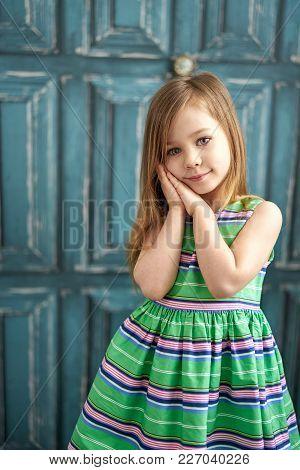 Four Years Girl Posing Against Vintage Blue Door