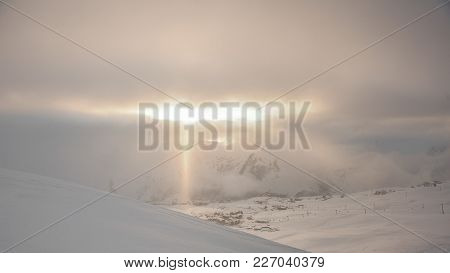 Beautiful Landscape Of The High Mountain Peaks Covered With Snow Under The Golden Sun Rays