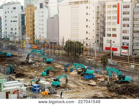 Large And Active Building Construction Site. In Asia, With All Visible Trademarks, Brands, Signage A