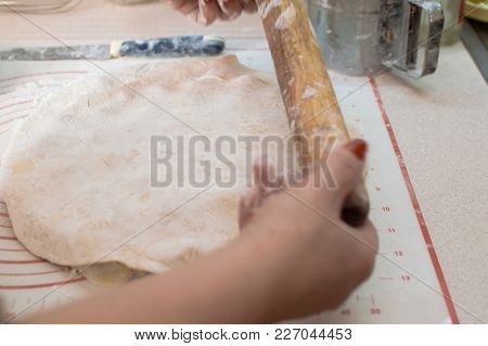 Close-up View Of The Hands With Rolling Pin Making Potstickers.