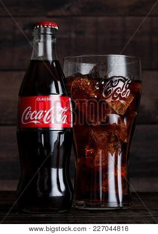 London, Uk - February 14, 2018:  Original Glass And Bottle Of Coca Cola Drink With Ice On Wooden Bac
