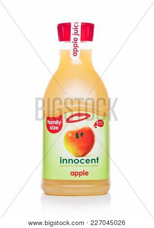 London, Uk - February 14, 2018: Plastic Bottle Of Innocent Apple Juice On White Background.family Si