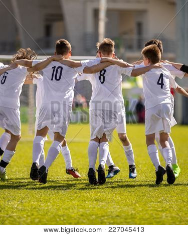 Happy Soccer Players. Happy Boys Winning Soccer Match. Young Successful Soccer Football Players Danc
