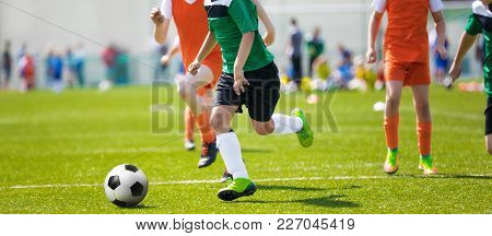Running Soccer Football Players. Footballers Kicking Football Match; Young Soccer Players Running  T