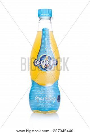London, Uk - February 14, 2018: Plastic Bottle Of Orangina Light Sparkling Fruit Soda Drink On White