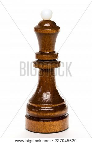 The Macro Shot Of The Black Chess Queen Of Wood On The White Background. The Chess Piece Is Isolated